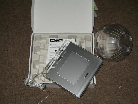 Unpacking the Wacom Graphic tablet.